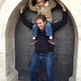 Me and Sebi, holding up the tiny back door into Matthias Church.