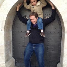 Me and Sebi, holding up the tiny back door into Matthias Church.